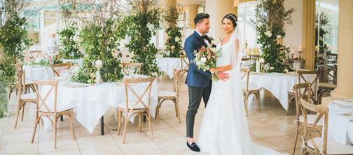 Bride and Groom in conservatory set up for wedding