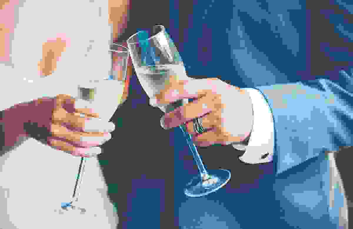 Birde and Groom holding Champagne glasses