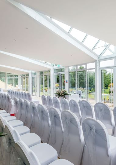 Conservatory wedding set up with view of golf course