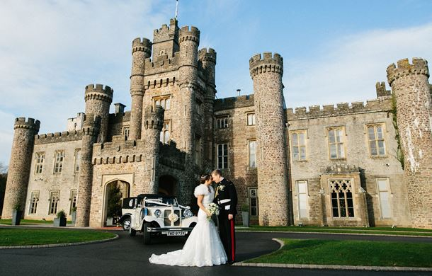 Bride and Groom with wedding car - Hensol Castle