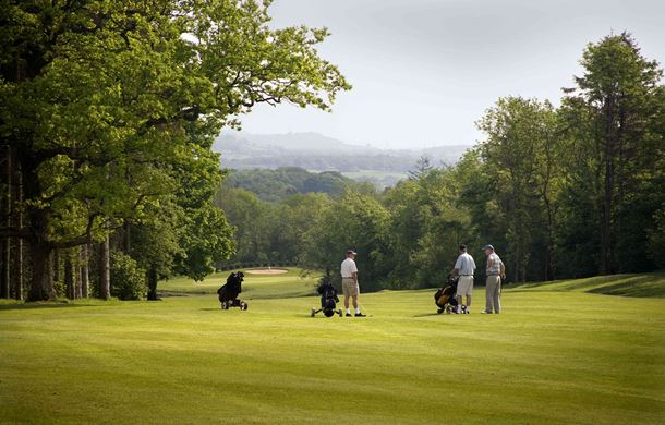 Golfers chatting on the Wales National Course