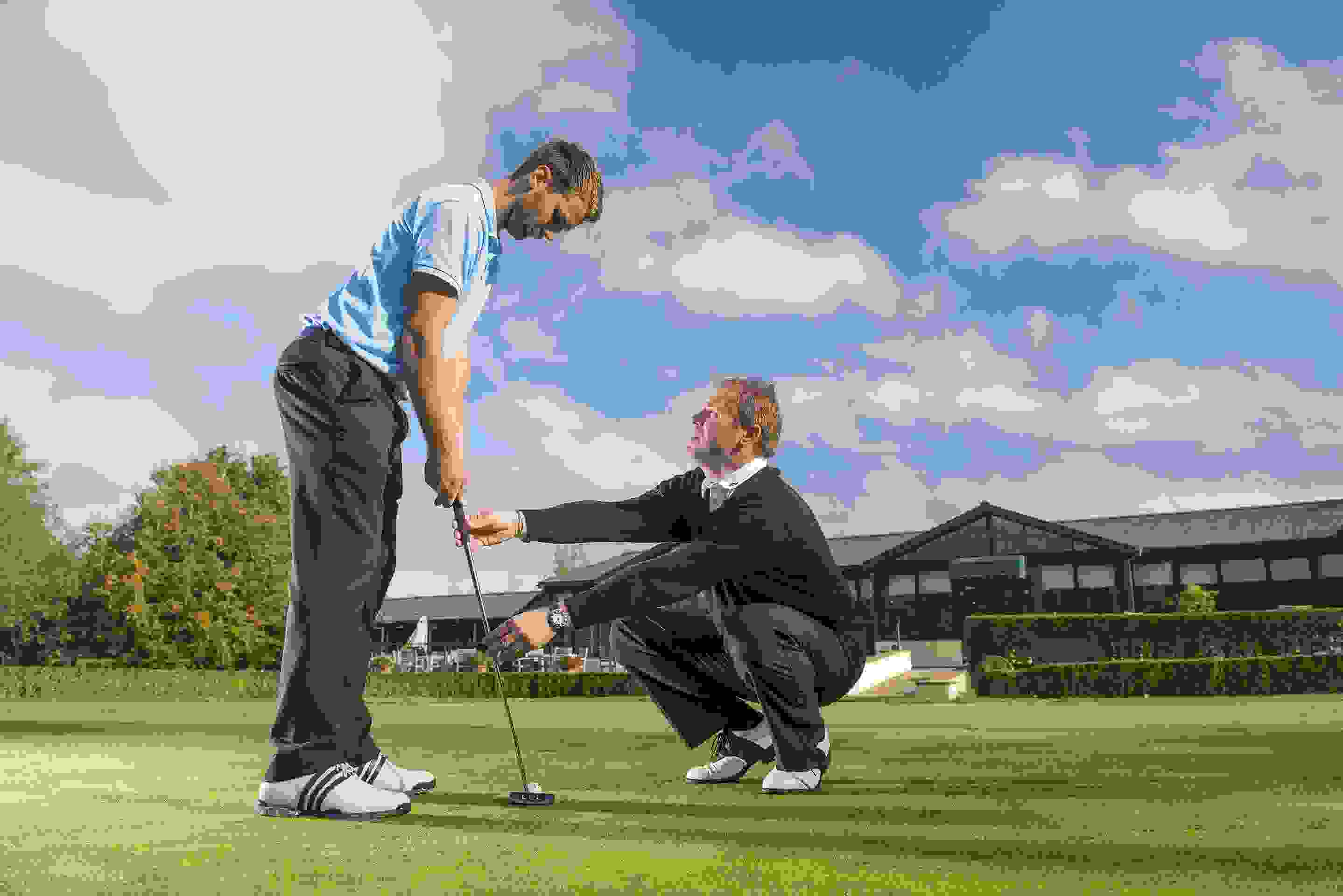 Golf pro coaching man at the Vale Resort
