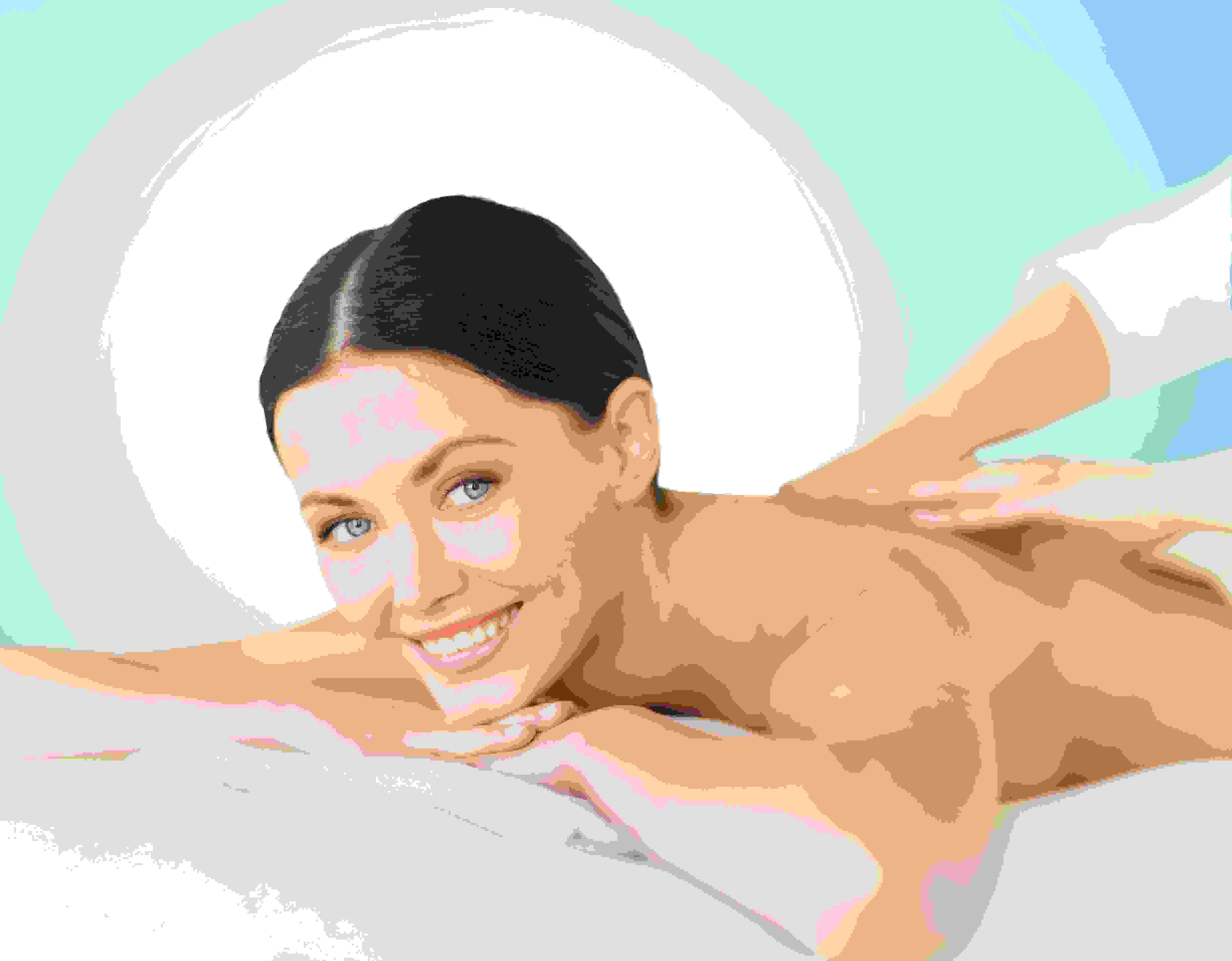 Woman smiling whilst have a back massage