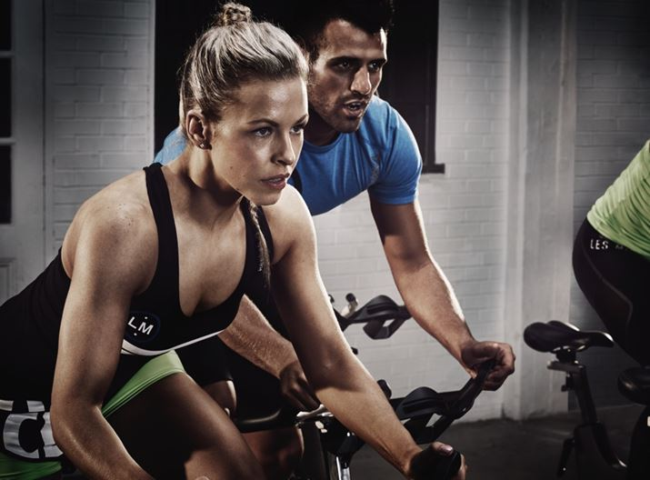 Woman and man in spin class