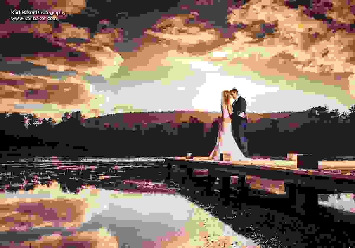 Bride and Groom hold each other on pier