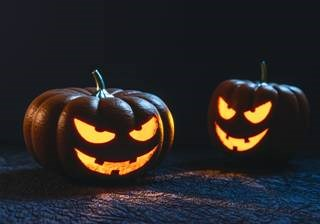 Two carved pumpkin faces